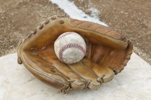 9737104-a-baseball-glove-in-a-baseball-diamond
