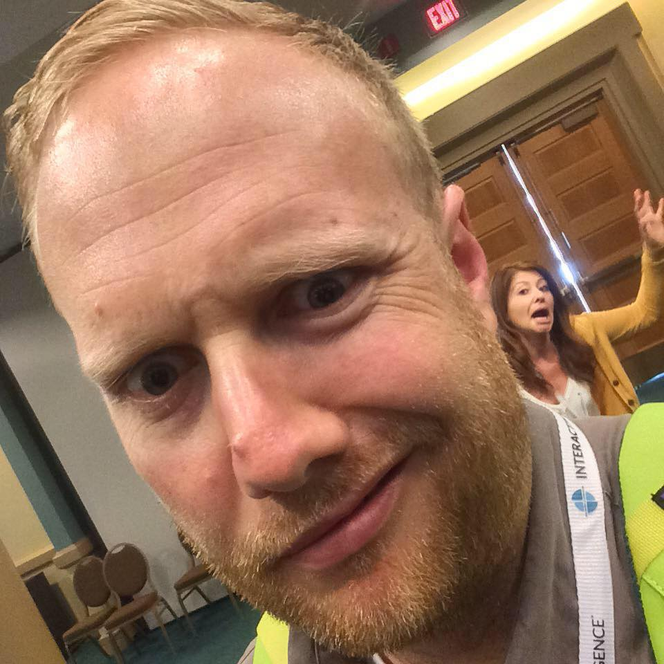 Jenny photobombing Jeremy's perfect diagonal selfie at the recent ICMI Contact Center Expo.